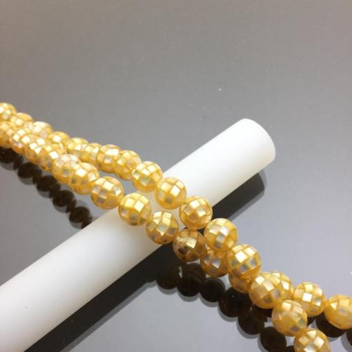 Chuỗi hạt vỏ ốc thiên nhiên màu vàng 10mm