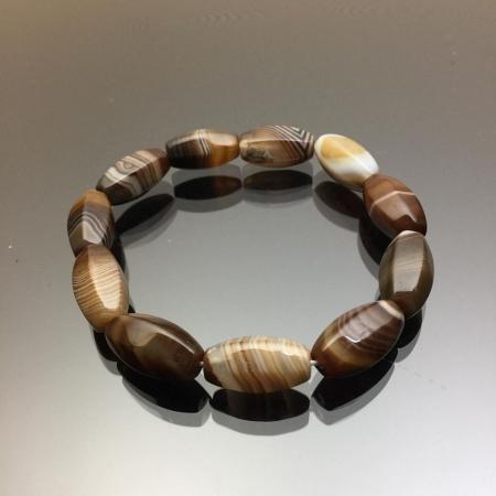 Vòng tay đá mã não Botswana Agate hình lu thống màu nâu 10mm