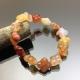 Vòng tay đá mã não Botswana Agate hoa mai màu cam 12mm